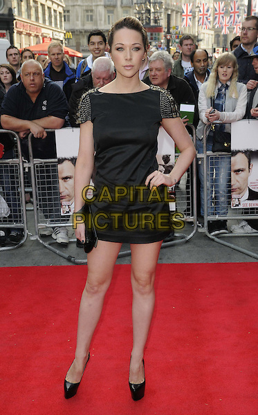 Emily Scott.The 'Klitschko' UK film premiere, Empire cinema, Leicester Square, London, England..May 21st, 2012.full length black dress hand on hip clutch bag.CAP/CAN.©Can Nguyen/Capital Pictures.