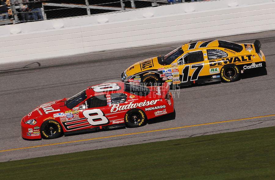 Feb 17, 2007; Daytona, FL, USA; Nascar Nextel Cup Series driver Dale Earnhardt Jr (8) races alongside Matt Kenseth (17) during practice for the Daytona 500 at Daytona International Speedway. Mandatory Credit: Mark J. Rebilas