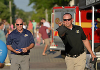 NWA Democrat-Gazette/BEN GOFF &bull; @NWABENGOFF<br /> Bryan Pratt (left) Bentonville West High School football coach, takes on Bentonville High coach Jody Grant in a game of cornhole on Friday Aug. 7, 2015 during the Back to School Celebration First Friday on the Bentonville square. Pratt and Bentonville West principal Jonathon Guthrie defeated Grant and Bentonville principal Jack Loyd 21-9.