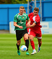 Gainsborough Trinity's Charlie Garter shields the ball from Lincoln City's Jack McMenemy<br /> <br /> Photographer Andrew Vaughan/CameraSport<br /> <br /> Pre-Season Friendly - Gainsborough Trinity v Lincoln City - Saturday 15th July 2017 - The Gainsborough Martin &amp; Co Arena - Gainsborough<br /> <br /> World Copyright &copy; 2017 CameraSport. All rights reserved. 43 Linden Ave. Countesthorpe. Leicester. England. LE8 5PG - Tel: +44 (0) 116 277 4147 - admin@camerasport.com - www.camerasport.com