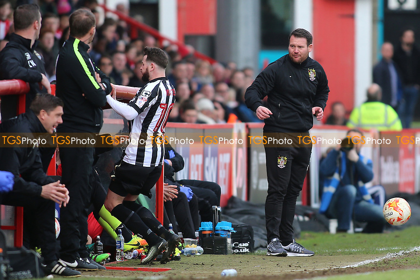 Mark Yeates of Notts County falls into the dugout as Stevenage manager Darren Sarll looks on during Stevenage vs Notts County, Sky Bet EFL League 2 Football at the Lamex Stadium on 4th March 2017