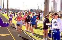 Track meet at a high school with teammates cheering runners.  St Paul Minnesota USA