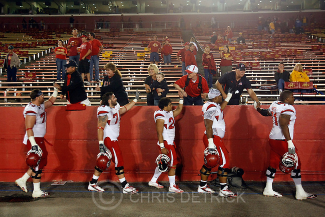 Chris Detrick  |  The Salt Lake Tribune .Utah fans high-five members of the football team after the game at Jack Trice Stadium in Ames, Iowa Saturday October 9, 2010.  The Utah Utes defeated the Iowa State Cyclones 68-27. The Utes are now undefeated at 5-0.