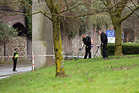 Pictured: Police officers with metal detectors serch the green at the Strand in Swansea, south Wales. Sunday 12 March 2017<br />
