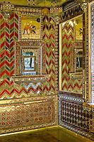 Ornate mirrored room, City Palace, Udaipur, India.