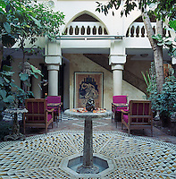 Tables and chairs are arranged in groups around the secluded inner courtyard