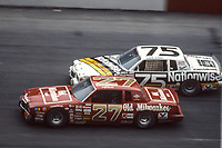 HAMPTON, GA - NOV 3:  Tim Richmond, #27 Pontiac, and Lake Speed, #75 Pontiac, race through a turn during the Atlanta Journal 500 NASCAR Winston Cup race at Atlanta Motor Speedway, November 3, 1985. (Photo by Brian Cleary/www.bcpix.com)