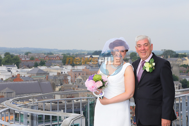 Emma Gallagher being given away by her father to Jake Cutlip at there wedding in Millmount<br /> Picture:  www.newsfile.ie