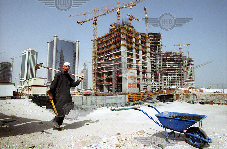 Workers from South Asia on a building site in Doha. The majority of those working in construction are from the Asian sub-continent and the Philippines. Migrant workers comprise 94 percent of Qatar's workforce and the country has the highest ratio of migrants to citizens in the world.