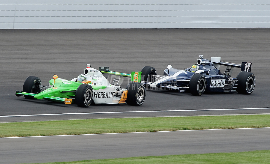May 24, 2009; Indianapolis, IN, USA; IRL driver Townsend Bell (8) leads Oriol Servia (17) during the 93rd running of the Indianapolis 500 at Indianapolis Motor Speedway.  Mandatory Credit: Mark J. Rebilas-