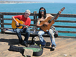 "Two young Musicians playing for tips (""Busking"") on the Oceanside Pier, on visit to Oceanside, CA, on Wednesday, April 27, 2016. Photo by Jim Peppler. Copyright Jim Peppler  2016."