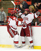 Colin Blackwell (Harvard - 63) and Kyle Criscuolo (Harvard - 11) celebrate Criscuolo's first collegiate goal. - The Harvard University Crimson defeated the visiting Brown University Bears 3-2 on Friday, November 2, 2012, at the Bright Hockey Center in Boston, Massachusetts.
