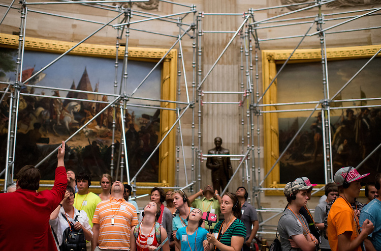 UNITED STATES - JULY 20: Scaffolding towers over tourists in the Capitol Rotunda on Monday morning, July 20, 2015. Tours of the Rotunda will be suspended from July 27th through September 7th as part of the ongoing Dome Restoration Project. (Photo By Bill Clark/CQ Roll Call)