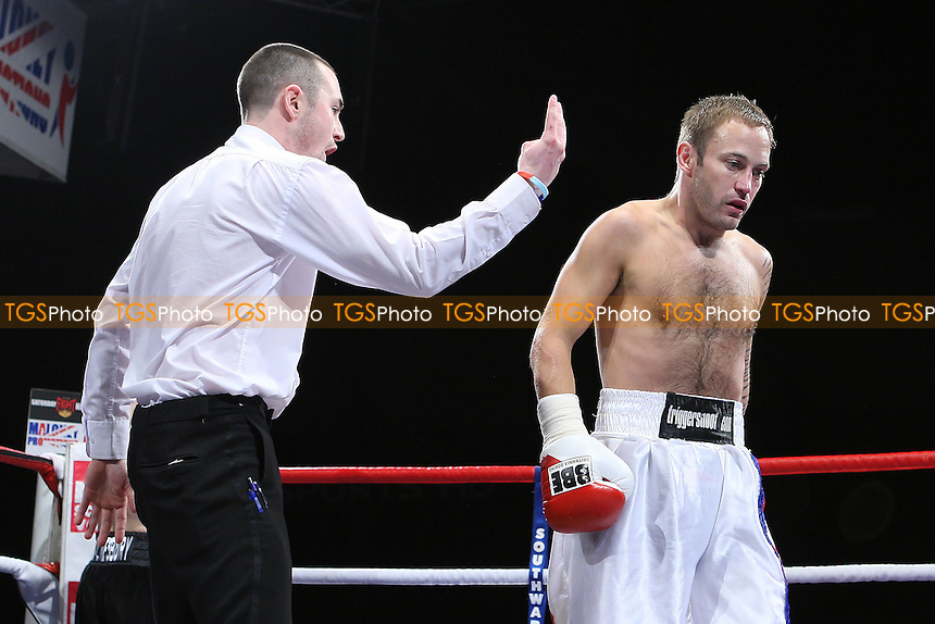 Joe Hughes (black shorts) defeats Gavin Putney in a Welterweight boxing contest at the Brentwood Centre, promoted by Frank Maloney - 05/02/11 - MANDATORY CREDIT: Gavin Ellis/TGSPHOTO - Self billing applies where appropriate - Tel: 0845 094 6026