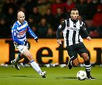 Nederland, Almelo, 22 december 2012.Eredivisie .Seizoen 2012-2013.Heracles Almelo-PEC Zwolle.Samuel Armenteros (r.) in actie met bal. Links Arne Slot van PEC Zwolle.