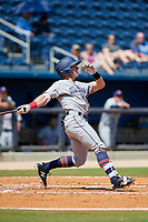 Jacksonville Jumbo Shrimp left fielder Kyle Barrett (4) follows through on a swing during a game against the Biloxi Shuckers on May 6, 2018 at MGM Park in Biloxi, Mississippi.  Biloxi defeated Jacksonville 6-5.  (Mike Janes/Four Seam Images)
