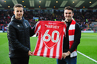 Lincoln City marketing manager Jake Longworth presents racing driver Jack Harvey with a personalised Lincoln City shit<br /> <br /> Photographer Chris Vaughan/CameraSport<br /> <br /> The EFL Sky Bet League Two - Lincoln City v Newport County - Saturday 22nd December 201 - Sincil Bank - Lincoln<br /> <br /> World Copyright © 2018 CameraSport. All rights reserved. 43 Linden Ave. Countesthorpe. Leicester. England. LE8 5PG - Tel: +44 (0) 116 277 4147 - admin@camerasport.com - www.camerasport.com