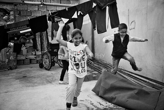 4.4..2015, Kirkuk,Iraq: Asma, Marwa, Marta and Abdullah gathering in the same patio for playing in the afternoons .