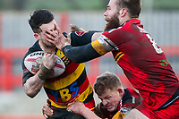 Picture by Alex Whitehead/SWpix.com - 11/02/2018 - Rugby League - Betfred Championship - Dewsbury Rams vs London Broncos - Tetleys Stadium, Dewsbury, England - Dewsbury's Gareth Moore is tackled by London's Thomas Spencer and Jordan Johnstone.