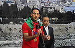 Members of Palestinian national football team arrive at Palestinian President Mahmoud Abbas's office after they won the AFC Challenge Cup, in the West Bank city of Ramallah on June 1, 2014. Palestine qualified for their maiden Asian Cup appearance with a 1-0 win over injury-hit Philippines in the final of the AFC Challenge Cup in Maldives. Photo by Issam Rimawi