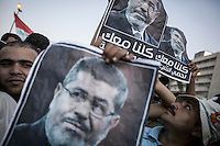 In this Sunday, Jul. 07, 2013 photo, members of the Muslim Brotherhood hold posters of the ousted president Mohammed Morsi during a rally at the Republican Guard Headquarters in cairo, Egypt. (Photo/Narciso Contreras).