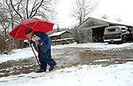 Journal Photo By Ted Richardson:  12/4/2003  John Fleming, 86, walks the mail back to his house in Boonville on a wintry Thursday afternoon.  About an inch of snow-and-sleet mixture had accumulated on the ground, with more of the same forecasted for Thursday night.  m CIT 05 weather 1 ric .jpg.J 12-05-03, A1, Standalone.