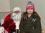 Saoirse Carron met Santa at the Christmas fair in the Market house Duneer. Photo:Colin Bell/pressphotos.ie