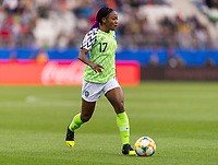 REIMS, FRANCE - JUNE 08: Francisca Ordega #17 dribbles forward during a game between Norway and Nigeria at Stade Auguste-Delaune on June 8, 2019 in Reims, France.