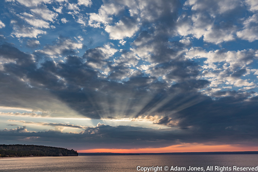 Sunset and light rays over Lake Superior, Pictured Rocks National Lakeshore, Upper Peninsula, Michigan.