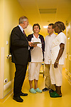 Dr Jean-Pierre Droz, Oncology unit, Centre Leon Berard, Lyon, France. The doctor with Liliane Dinga, femme de service, and with Sylvie Reynier, infirmiare principal, staff nurse, and with trainee Michel Zimmermann.
