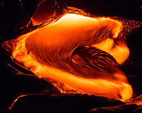 Pele's Lava Wave: Pouring molten lava looks like a lava wave, 61g flow field at night, Hawai'i Volcanoes National Park, Big Island.