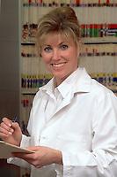 Woman medical professional among medical records.