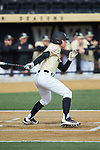 Nick DiPonzio (7) of the Wake Forest Demon Deacons follows through on his swing against the Louisville Cardinals at David F. Couch Ballpark on March 18, 2018 in  Winston-Salem, North Carolina.  The Demon Deacons defeated the Cardinals 6-3.  (Brian Westerholt/Sports On Film)