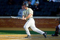 Joey Rodriguez (7) of the Wake Forest Demon Deacons follows through on a 3-run home run against the Virginia Cavaliers at Wake Forest Baseball Park on April 6, 2013 in Winston-Salem, North Carolina.  (Brian Westerholt/Four Seam Images)