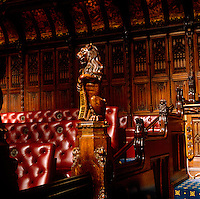 A carved heraldic lion surveys the Chamber in the House of Lords
