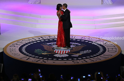 United States President Barack Obama (R) dances with first lady Michelle Obama at the Commander-in-Chief Ball on January 21, 2013 in Washington, DC. Pres. Obama was sworn-in for his second term as president during a public ceremonial inauguration earlier in the day.  .Credit: Justin Sullivan / Pool via CNP