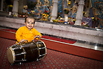 © Joel Goodman . 18 May 2013 . Gita Bhavan Hindu Temple , Withington Road , Whalley Range , Manchester . Kayur Sharma (one) in yellow . Commemorative service to celebrate the handover of the Green Kumbh Yatra (green journey pot or environmental pilgrimage) at the Gita Bhavan Hindu Temple in Manchester . The pot has travelled to the Maha Kumbh Mela , Kenya , Nepal and the Western Wall in Jerusalem along the way . At every place of rest an environmental action must be taken to reflect the pot's environmental significance . It's due to travel to Leicester and feature in an outdoor procession in London on 24th May 2013 . Photo credit : Joel Goodman