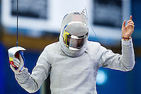 27 FEB 2011 - LONDON, GBR - China's Zhu Min celebrates a point during the final of fencing's  England Cup team sabre tournament against Russia at the National Sports Centre at Crystal Palace .(PHOTO (C) NIGEL FARROW)