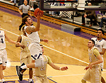 SIOUX FALLS, SD - NOVEMBER 25: Trevon Evans #4 from the University of Sioux Falls drives to the basket against Southwest Minnesota State University during their game Saturday night at the Stewart Center in Sioux Falls. (Photo by Dave Eggen/Inertia)