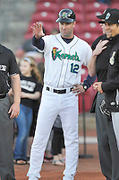 Cedar Rapids Kernels Manger Jake Mauer (12)discusses the ground rules with the umpires prior to the game against the Clinton LumberKings at Veterans Memorial Stadium on April 14, 2016 in Cedar Rapids, Iowa.  The Kernels won 7-3.  (Dennis Hubbard/Four Seam Images)