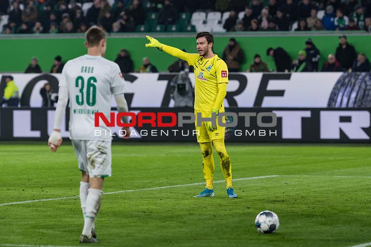01.12.2019, Volkswagen Arena, Wolfsburg, GER, 1.FBL, VfL Wolfsburg vs SV Werder Bremen<br /><br />DFL REGULATIONS PROHIBIT ANY USE OF PHOTOGRAPHS AS IMAGE SEQUENCES AND/OR QUASI-VIDEO.<br /><br />im Bild / picture shows<br />Christian Groß / Gross (Werder Bremen #36), <br />Jiri Pavlenka (Werder Bremen #01), <br /><br />Foto © nordphoto / Ewert