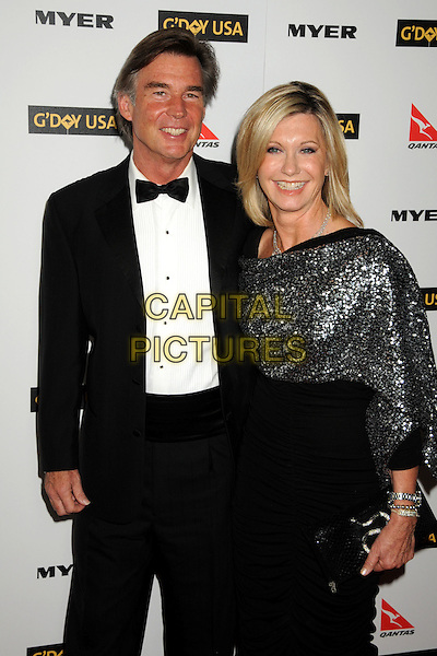 JOHN EASTERLING, OLIVIA NEWTON-JOHN.Attending the 2010 G'Day USA Australia Week Black Tie Gala held at the Hollywood & Highland Grand Ballroom, Hollywood, California, USA, .16th January 2010..arrivals half length black bow tie tuxedo tux sequined sequin shawl wrap silver married couple husband wife clutch bag bracelets dress .CAP/ADM/BP.©Byron Purvis/Admedia/Capital Pictures