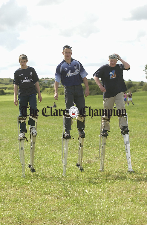 Stilt walkers, David Murphy, John Mc Grath  and David Mc Grath entertain the crowd at the Burren Festival in Carron. Photograph by John Kelly.