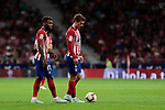Atletico de Madrid's Thomas Lemar (L) and Antoine Griezmann (R) during La Liga match between Atletico de Madrid and SD Huesca at Wanda Metropolitano Stadium in Madrid, Spain. September 25, 2018. (ALTERPHOTOS/A. Perez Meca)