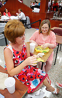 NWA Democrat-Gazette/DAVID GOTTSCHALK  Tracy Benson (left) and Susan Stewart, both of Parson Hills Elementary School, enjoy their breakfast during the Springdale School District annual appreciation breakfast at Springdale High School Monday, August 10, 2015. The teachers received items from vendors, ate breakfast and participated in a welcoming program.