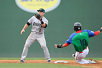 Shortstop Jeremy Sy (2) of the Augusta GreenJackets gets the throw too late as Mauricio Dubon of the Greenville Drive steals second in a game on Sunday, April 12, 2015, at Fluor Field at the West End in Greenville, South Carolina. Augusta won, 2-1. (Tom Priddy/Four Seam Images)