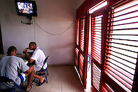 024222.SP.0114.angels14.kc--San Pedro de Macoris, Dominican Republic--Daytime sitcoms play as lunch is served in the upstairs dining area of the Angels' facility after the game between Anaheim Angels Academy Team and the Boston Red Sox Academy Team. At a young age Dominican boys learn that baseball could be their chance to make it big. Baseball academies run by MLB teams provides an all around learning experience for boys once they reach sixteen. Balanced meals are served to the players something that some wouldn't get if it weren't for the academy.