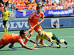 The Hague, Netherlands, June 15: Marcel Balkestein #5 of The Netherlands and Matthew Swann #20 of Australia battle for the ball during the field hockey gold match (Men) between Australia and The Netherlands on June 15, 2014 during the World Cup 2014 at Kyocera Stadium in The Hague, Netherlands. Final score 6-1 (2-1)  (Photo by Dirk Markgraf / www.265-images.com) *** Local caption ***