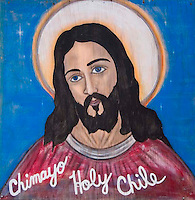 Painting of Jesus Christ advertising holy chiles at a cafe near the Lourds of America in Chimayo, New Mexico.