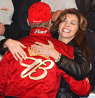 Dale Earnhardt Jr. receives a hug from his step-mother and car owner Teresa Earnhardt in victory lane at Daytona International Speedway after winning the Budweiser Shootout.